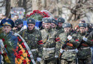 Ukranian soldiers carry the coffin of a comrade, who was killed while defending a radar station from attackers, during his funeral in Kharkiv