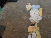 Утреннее фото: запорожский подъезд украсили Симпсонами