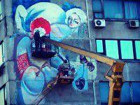 Фотофакт: В Запорожье еще один дом украсили живописной картиной