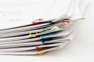 Pack of sheets of paper fastened by paper clips