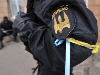 Pro-Ukrainian militants of the so-called 'Donbas battalion' gather at their base at an undisclosed location in the Donesk region on May 22, 2014. Ukrainian President Oleksandr Turchynov said on May 22 that 14 troops had been killed in two overnight attacks by rebel forces in the separatist east of the country. AFP PHOTO/ GENYA SAVILOV