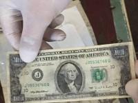 В Запорожской области заключенный превращал один доллар в сто