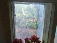 В дом переселенки, раненой несколько лет назад, снова попала пуля