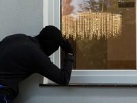 Burglar looks into house through the window