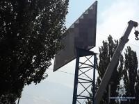 Владелец билборда угрожал коммунальщикам и устроил средь бела дня стрельбу