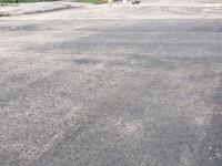 Попытка №2: в старой части Запорожья переделали асфальт, потрескавшийся после дождя