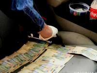 В Запорожье чиновника задержали со взяткой в растаможенном авто
