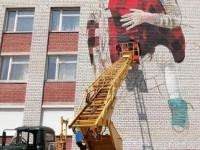 Чтобы приобщить к искусству: на фасаде трех запорожских школ создают муралы